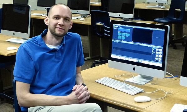 Eudora High School teacher Nate Robinson is back in his computer and video editing classroom after a first semester in which he was in the hospital for 20 days from heart complications and ended up having surgery to place an artificial valve in his heart. During winter break, Robinson learned he won $50,000 in an online contest. He is shown on Jan. 18, 2017.