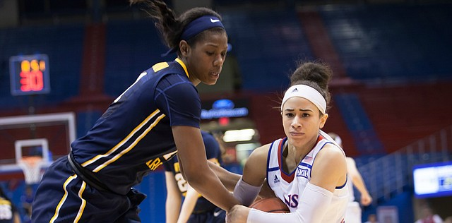 Kansas' Jessica Washington (3) wrestles the ball from West Virginia's Teana Muldrow (11) late in the third quarter of Wednesday night's game. West Virginia won, 62-51.