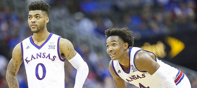 Kansas guard Frank Mason III (0) and Kansas guard Devonte' Graham (4) watch a free throw during the second half, Tuesday, Nov. 22, 2016 during the championship game of the CBE Classic at Sprint Center.