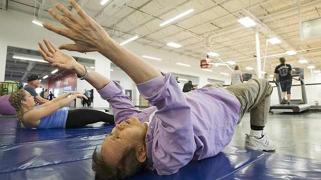 Lawrence resident and University of Kansas distinguished professor emeritus Po-Lung Yu performs stretching exercises on Friday, Jan. 20, 2017 at Sports Pavilion Lawrence. Lawrence city staff is working on a policy to address the naming rights of parks and recreation facilities.