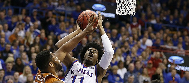 Kansas guard Josh Jackson (11) puts a shot over Texas forward Shaquille Cleare (32) during the first half, Saturday, Jan. 21, 2017 at Allen Fieldhouse. At right is Texas forward Jarrett Allen (31).