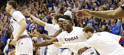 The Kansas bench applauds a three by Kansas guard Sviatoslav Mykhailiuk late in the second half, Saturday, Jan. 21, 2017 at Allen Fieldhouse.