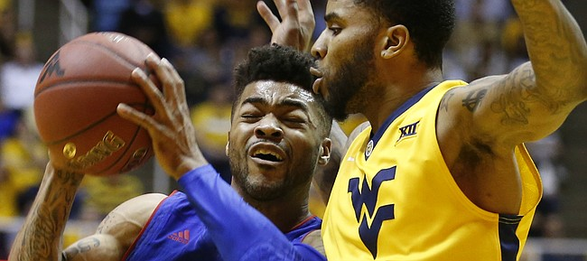 Kansas guard Frank Mason III (0) drives against West Virginia guard Tarik Phillip (12) during the first half, Tuesday, Jan. 24, 2017 at WVU Coliseum.