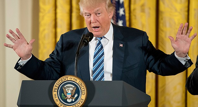President Donald Trump speaks during a White House senior staff swearing in ceremony in the East Room of the White House, Sunday, Jan. 22, 2017, in Washington. (AP Photo/Andrew Harnik)