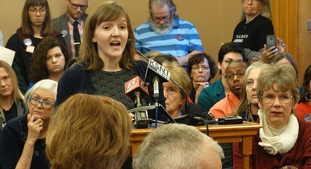 University of Kansas graduate student Megan Jones is shown in this file photo from Jan. 26, 2017, testifying at a Kansas Senate committee hearing in favor of a bill to allow colleges, universities and local governments to continue banning the carrying of concealed weapons in public buildings.