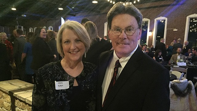 Emprise Bank Market President Cindy Yulich, left, and city commissioner and business owner Mike Amyx are shown at the Lawrence chamber of commerce's annual meeting on Friday, Jan. 27, 2017, where they received awards recognizing outstanding commitment to the Lawrence community.