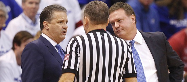 Kentucky head coach John Calipari and Kansas head coach Bill Self have a joint meeting with an official after a double technical foul during the first half, Saturday, Jan. 30, 2016 at Allen Fieldhouse.