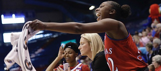 Kansas guard Chayla Cheadle (22), right, cheers from the KU bench after a late three-point basket by teammate Kylee Kopatich in the Jayhawks win over Texas Tech Saturday, Jan. 28, 2017, in Lawrence, Kan.