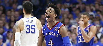 Kansas guard Devonte' Graham (4) turns to the bench with excitement as the Jayhawks pulls away during the second half against Kentucky, Saturday, Jan. 28, 2017 at Rupp Arena in Lexington, Kentucky.