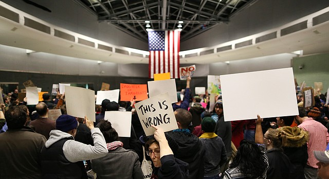 People participate in a peaceful demonstration against President Donald Trump's immigration policies at International Arrivals Hall inside Philadelphia International Airport, Saturday, Jan. 28, 2017. (Joseph Kaczmarek/The Philadelphia Inquirer via AP)
