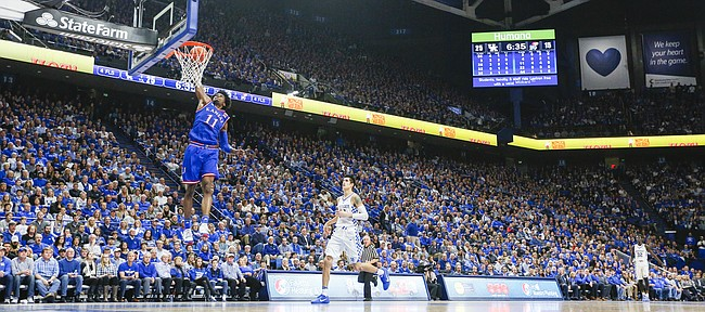 Kansas guard Josh Jackson (11) comes in for a breakaway dunk during the first half, Saturday, Jan. 28, 2017 at Rupp Arena in Lexington, Kentucky.