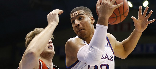 Kansas forward Landen Lucas (33) catches a pass inside against Texas Tech forward Matthew Temple (34) during the second half, Saturday, Jan. 7, 2017 at Allen Fieldhouse.