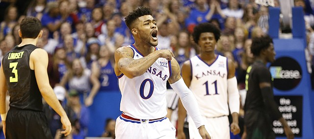 Kansas guard Frank Mason III (0) beats his chest during a Jayhawk run against Baylor in the second half, Wednesday, Feb. 1, 2017 at Allen Fieldhouse.