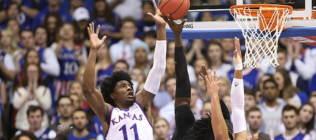 Kansas guard Josh Jackson (11) and Kansas forward Landen Lucas battle down low with Baylor forward Johnathan Motley (5) and Baylor forward Jo Lual-Acuil Jr. (0) during the first half, Wednesday, Feb. 1, 2017 at Allen Fieldhouse.