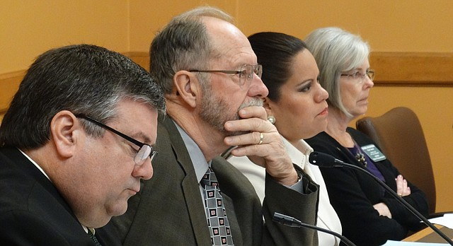 Reps. Ken Rahjes, Tom Sloan, Ponka-We Victors and Susie Swanson, members of the House Committee on Water and Environment, listen Jan. 31, 2017, during testimony on a bill to increase fees to fund the State Water Plan.