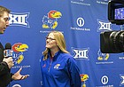University of Kansas softball head coach Megan Smith talks with broadcaster Brian Hanni about the upcoming season during Softball Media Day on Thursday, Feb. 2, 2017 at Rock Chalk Park.