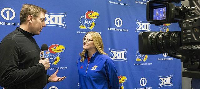 University of Kansas softball head coach Megan Smith talks with broadcaster Brian Hanni about the upcoming season during Softball Media Day on Thursday, Feb. 2, 2017 at Rock Chalk Park.