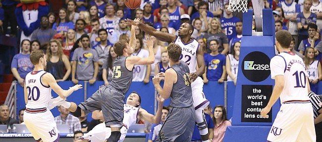 Kansas forward Mitch Lightfoot (44) takes a charge from Emporia State guard Jack Dale (35) as Kansas forward Dwight Coleby (22) rejects his shot during the second half, Sunday, Nov. 6, 2016 at Allen Fieldhouse.