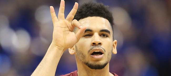 Iowa State guard Nazareth Mitrou-Long (15) celebrates a three during the second half, Saturday, Feb. 4, 2017 at Allen Fieldhouse.