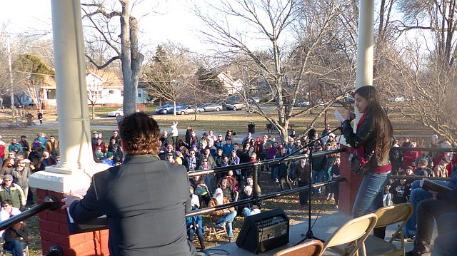 Lacee Roe, district advocate of CARE International, addresses the Lawrence Stands with Refugees event Saturday, Feb. 4, 2017 at South Park. She was a co-organizer of the event, which drew about 400 people to show solidarity with those affected by President Donald Trump's travel ban.