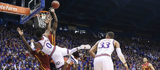 Kansas guard Frank Mason III (0) is fouled on the shot by Iowa State forward Solomon Young (33) during the first half, Saturday, Feb. 4, 2017 at Allen Fieldhouse.