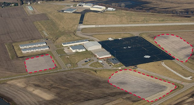 This aerial photograph from March 17, 2009, shows the Lawrence Municipal Airport. This view is from the southeast looking to the northwest. The three areas framed with a red dashed line have been determined by an off-site Federal Aviation Administration study to be potentially safe to accommodate parachute landings, as long as certain provisions are met. However, the Lawrence City Commission will still have to determine whether skydiving should be allowed at the airport, and that decision likely will not come as early as this week.