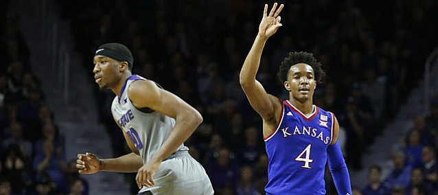Kansas guard Devonte' Graham (4) hangs up his hand after hitting a three over Kansas State forward Xavier Sneed (20) during the second half, Monday, Feb. 6, 2017 at Bramlage Coliseum.