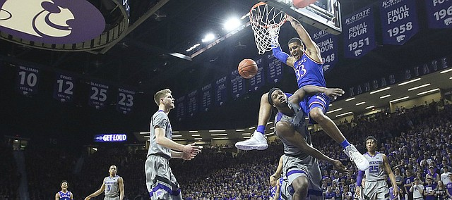 Kansas forward Landen Lucas (33) explodes for a dunk and a foul from Kansas State forward D.J. Johnson (4) during the second half, Monday, Feb. 6, 2017 at Bramlage Coliseum.