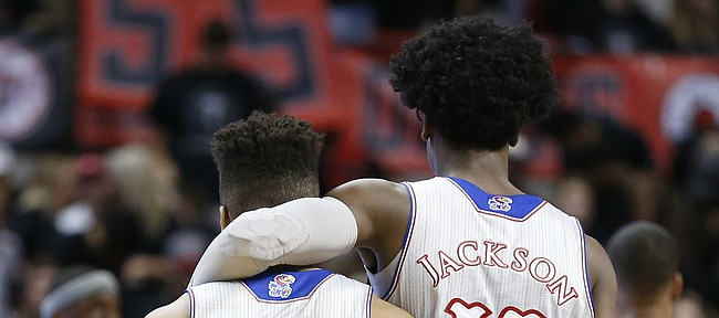 Kansas guard Josh Jackson (11) puts his arm around teammate Frank Mason III (0) during a timeout in the first half, Saturday, Feb. 11, 2017 at United Supermarkets Arena in Lubbock, Texas.
