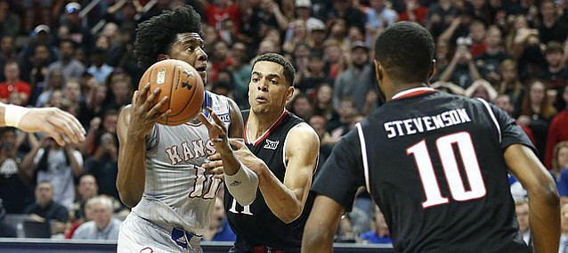 Kansas guard Josh Jackson (11) is fouled on the drive by Texas Tech forward Zach Smith (11) with seconds remaining in regulation, Saturday, Feb. 11, 2017 at United Supermarkets Arena in Lubbock, Texas. The foul put Jackson at the free throw line where he hit the second of two shots to give the Jayhawks a one-point lead and ultimately, the win.