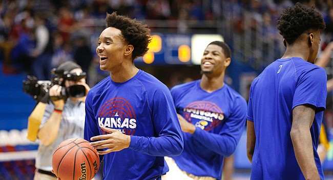 Kansas junior Devonte Graham shares a laugh with his teammates during pregame warmups prior to Monday's game against West Virginia in Allen Fieldhouse.