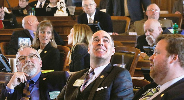 House Tax Committee Chairman Rep. Steven Johnson, R-Assaria, watched the tally board Wednesday Feb. 15, 2017, as the vote was taken on House Bill 2178 which he carried on the floor of the House, in Topeka, Kan. The House, with no debate, gave early approval by a robust margin Wednesday to legislation increasing personal income taxes and reinstating taxes on some businesses. (Thad Allton /The Topeka Capital-Journal via AP)