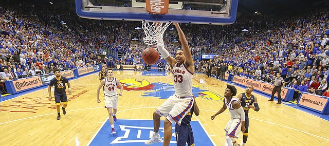 Kansas forward Landen Lucas (33) delivers a dunk during the second half, Monday, Feb. 13, 2017 at Allen Fieldhouse.