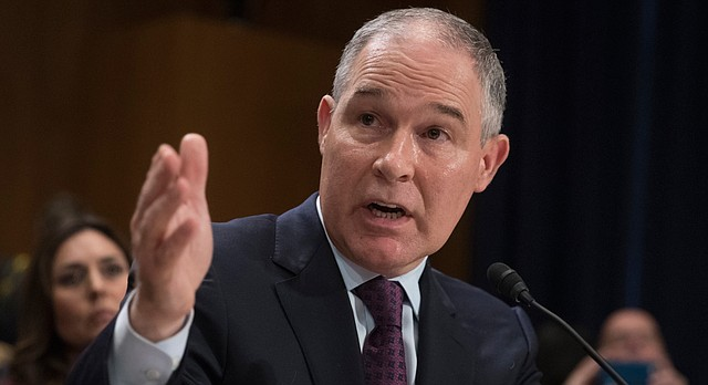 In this Jan. 18, 2017, file photo,Environmental Protection Agency Administrator nominee, Oklahoma Attorney General Scott Pruitt testifies on Capitol Hill in Washington at his confirmation hearing before the Senate Environment and Public Works Committee. (AP Photo/J. Scott Applewhite, File)