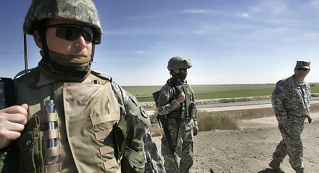 In this March 2, 2007 file photo, Tennessee National Guard Sgt. Phillip Williams of Gatlinburg stands guard near the Mexican border in Yuma, Ariz. (AP Photo/John Partipilo, Pool, File)
