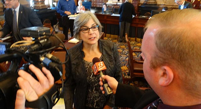 Senate President Susan Wagle, R-Wichita, speaks with reporters immediately after the Senate voted 22-18 to send a tax bill to Gov. Sam Brownback that reverses some of the tax cuts he championed in 2012.