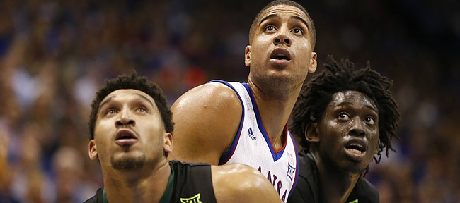 Kansas forward Landen Lucas (33) fights for position with Baylor guard Ishmail Wainright, front, and Baylor forward Johnathan Motley during the second half, Wednesday, Feb. 1, 2017 at Allen Fieldhouse.
