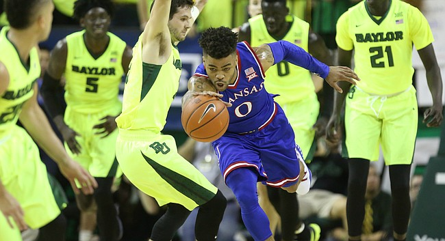 Kansas guard Frank Mason III (0) pushes the ball up the court past Baylor guard Jake Lindsey (3) during the first half, Saturday, Feb. 18, 2017 at Ferrell Center in Waco, Texas.