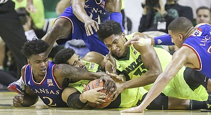 From left, Kansas guard Lagerald Vick (2), Josh Jackson (11) and Kansas forward Landen Lucas wrestle for a possession with Baylor guard Ishmail Wainright, left, and Baylor forward Terry Maston (31) during the first half, Saturday, Feb. 18, 2017 at Ferrell Center in Waco, Texas.