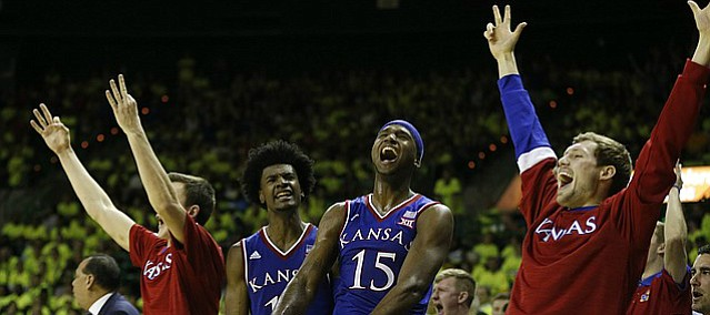The Kansas bench celebrates a three from Sviatoslav Mykhailiuk during a surge by the Jayhawks in the second half, Saturday, Feb. 18, 2017 at Ferrell Center in Waco, Texas.