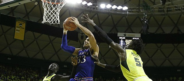 Kansas forward Landen Lucas (33) grabs a rebound and is fouled with seconds remaining during the second half, Saturday, Feb. 18, 2017 at Ferrell Center in Waco, Texas. Lucas hit both free throws to give the Jayhawks the lead.