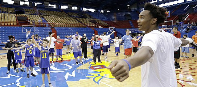 Devonte Graham leads exercises to a group of Special Olympians during the 33rd annual Wilt Chamberlain Special Olympics Clinic at Allen Fieldhouse Sunday. The KU men's basketball team assisted in the annual clinic.