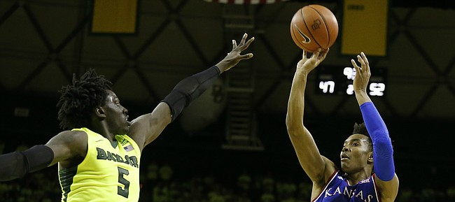 Kansas guard Devonte' Graham (4) puts a shot over Baylor forward Johnathan Motley (5) during the second half, Saturday, Feb. 18, 2017 at Ferrell Center in Waco, Texas.