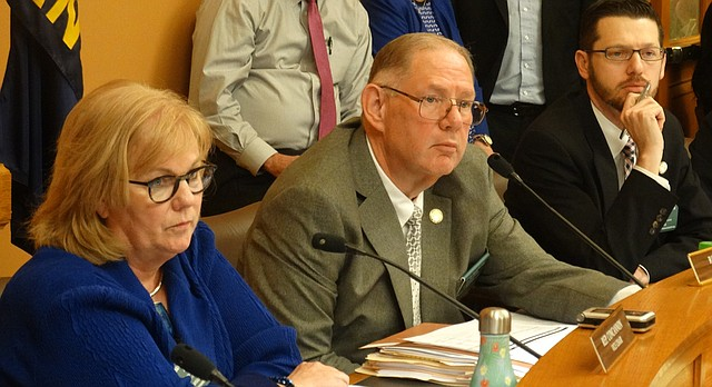 House Health and Human Services Committee Vice Chair Susan Concannon, left, Chairman Dan Hawkins, and ranking Democrat John Wilson listen during debate on a bill to expand the Kansas Medicaid program known as KanCare under the federal Affordable Care Act.