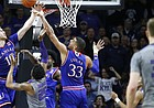 Kansas guard Sviatoslav Mykhailiuk (10) and Kansas forward Landen Lucas (33) reject a shot by Kansas State forward Wesley Iwundu (25) with under a minute to play during the second half, Monday, Feb. 6, 2017 at Bramlage Coliseum. In back is Kansas guard Josh Jackson (11).