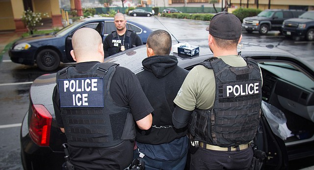In this photo taken Feb. 7, 2017, released by U.S. Immigration and Customs Enforcement, an arrest is made during a targeted enforcement operation conducted by U.S. Immigration and Customs Enforcement (ICE) aimed at immigration fugitives, re-entrants and at-large criminal aliens in Los Angeles. (Charles Reed/U.S. Immigration and Customs Enforcement via AP)