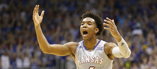 Kansas guard Devonte' Graham (4) celebrates a three during the first half, Wednesday, Feb. 22, 2017 at Allen Fieldhouse.