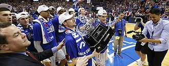 Kansas guard Tyler Self is handed the Big 12 Conference trophy following the Jayhawks' 87-68 win over TCU, Wednesday, Feb. 22, 2017 at Allen Fieldhouse.