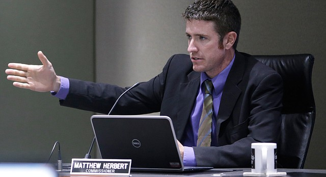 In this file photo from August 2015, Lawrence City Commissioner Matthew Herbert speaks during a meeting at City Hall.