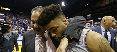 Kansas guard Frank Mason III (0) gets a hug from assistant coach Kurtis Townsend following the Jayhawks' win over TCU for their 13th-straight Big 12 conference title, Wednesday, Feb. 22, 2017 at Allen Fieldhouse.